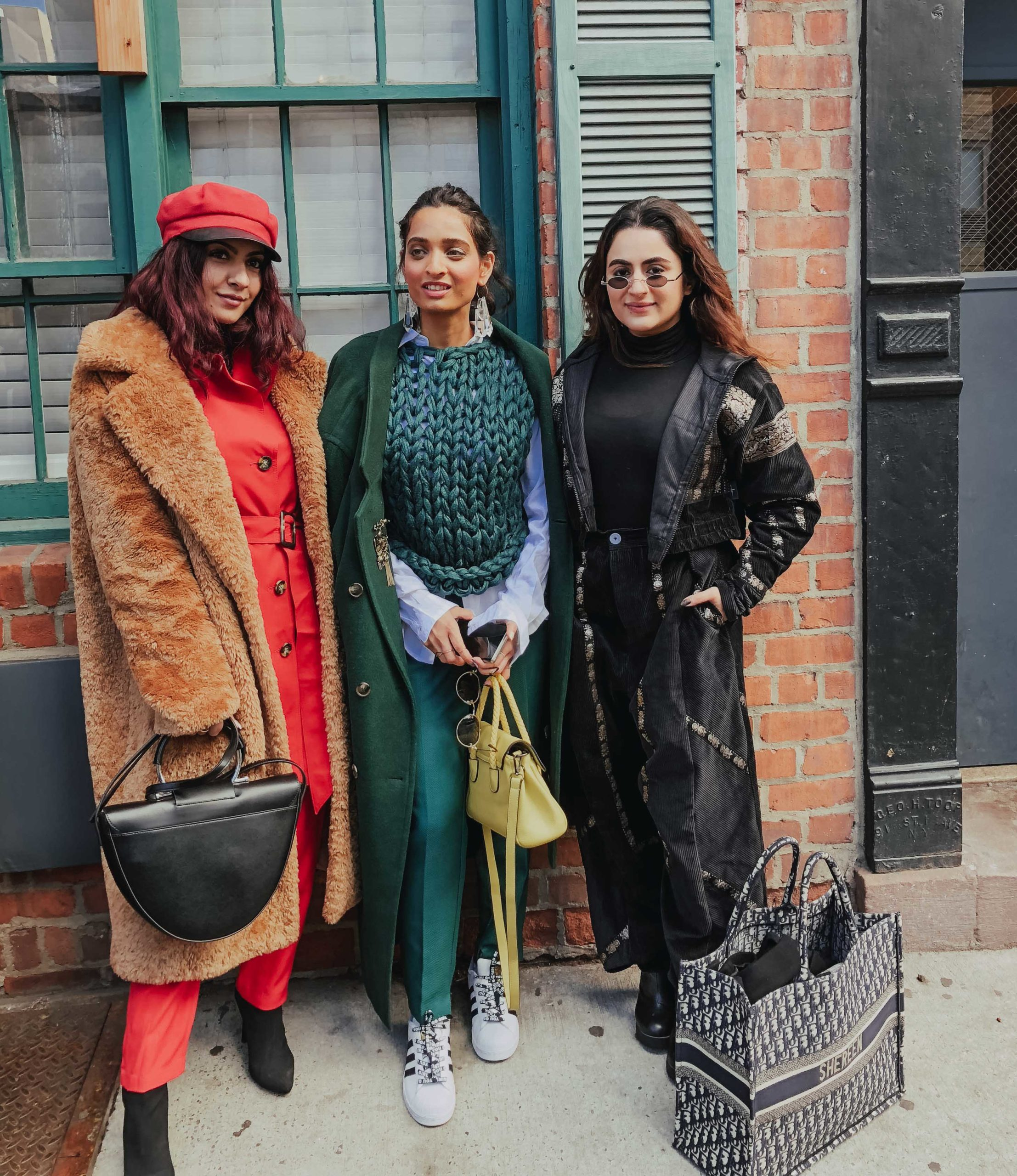 Girl fashion bloggers with streetystyle outfits at the new york fashion week 2019