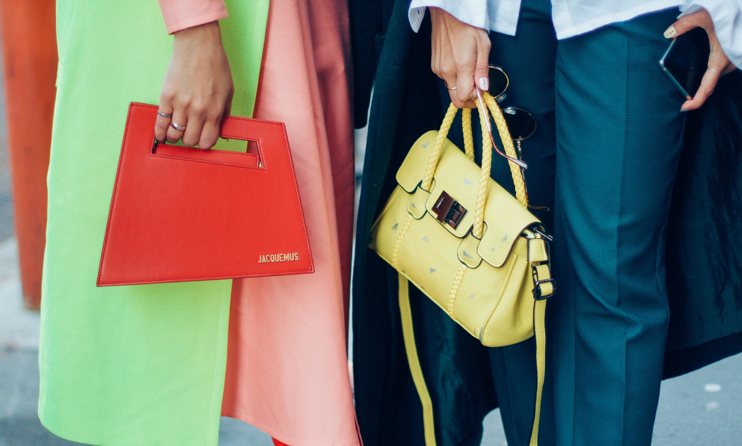 details from fashion week showing colour block outfits and red and yellow purse