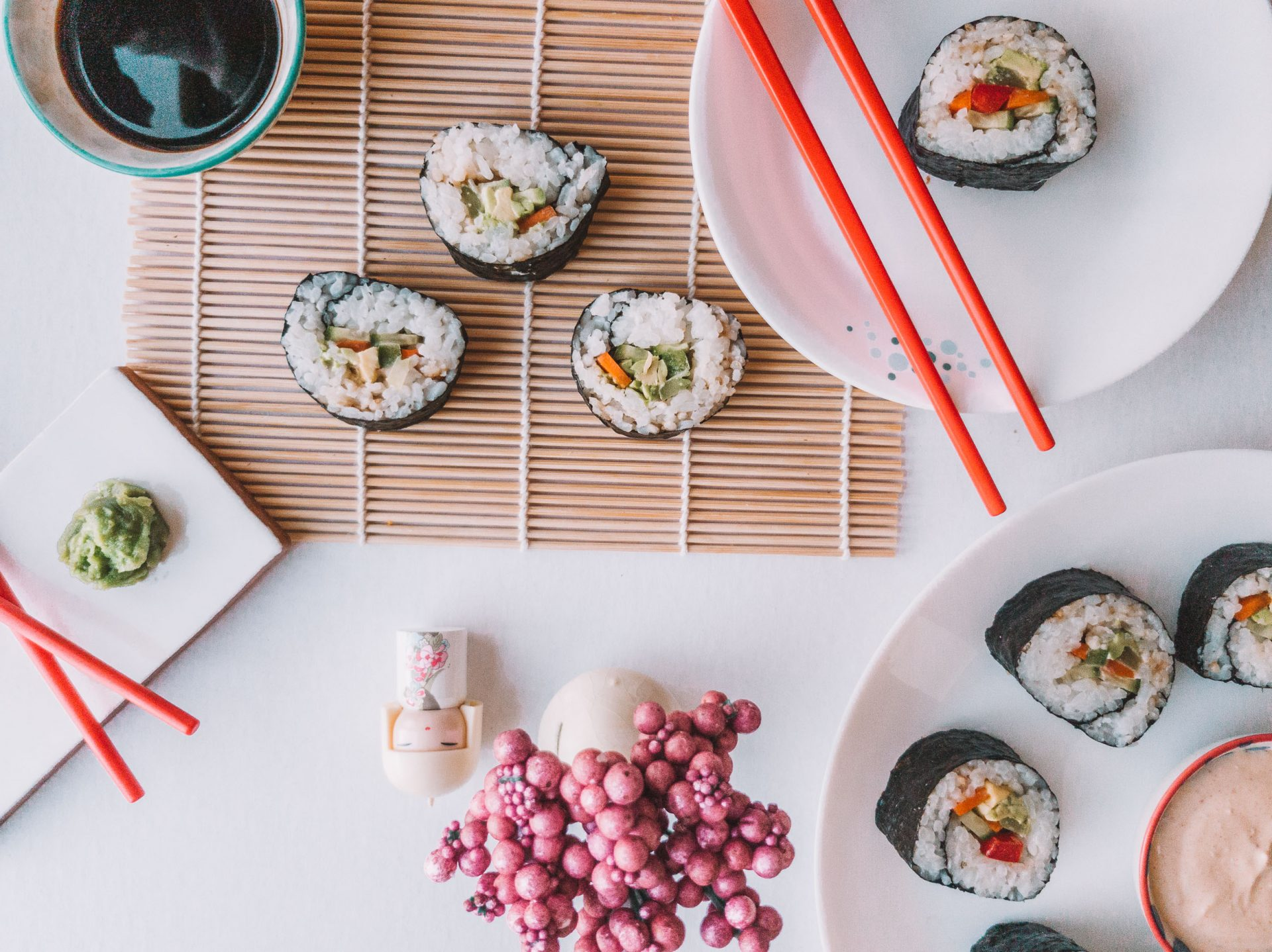 flatlay of vegetarian shushi rolls on sushi rolling mat