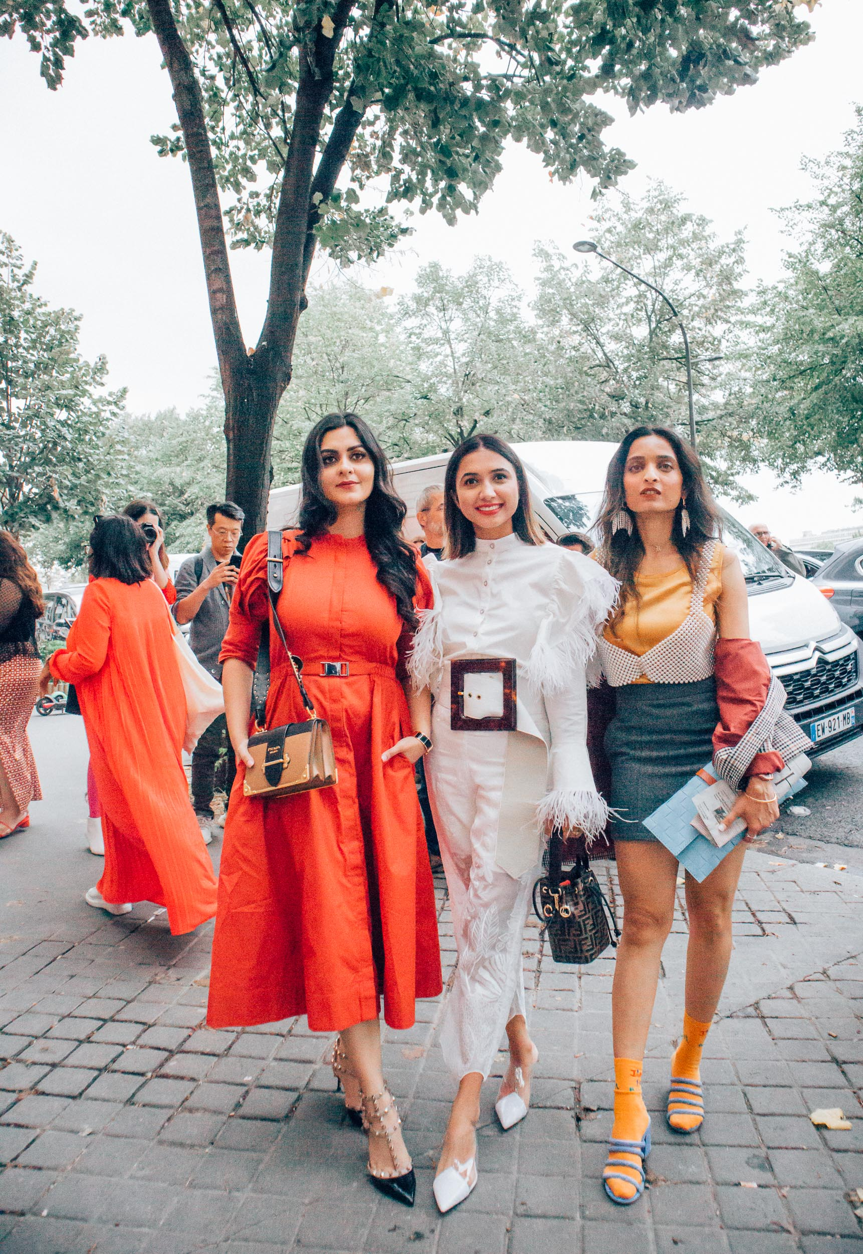Girl fashion bloggers standing dressed up for show at Paris Fashion week in Paris for Paris travel guide
