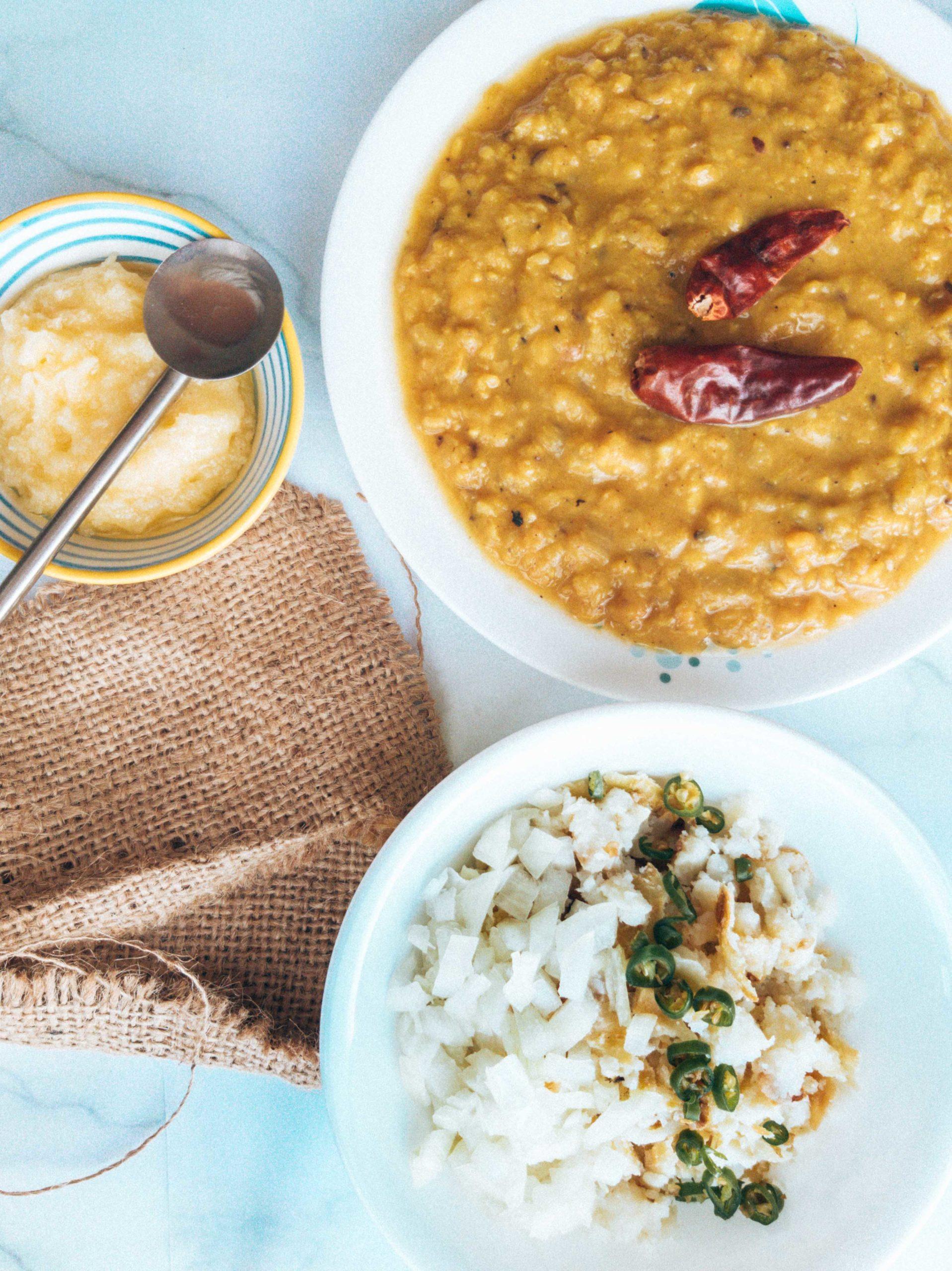 flatlay of food showing indian rajasthani dish called daal baati